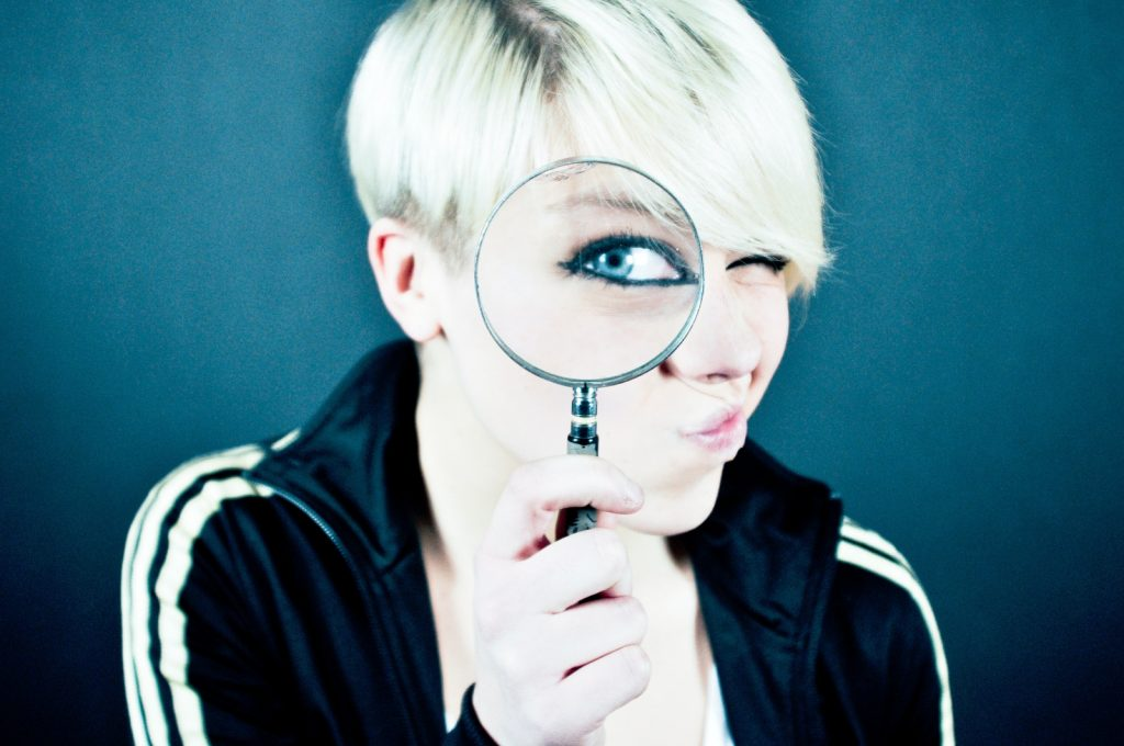 girl with magnifying glasses