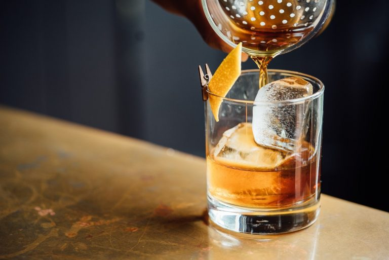 ice cubes in whiskey glass